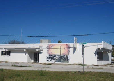 cross mural on building