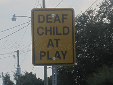 Deaf child at play sign