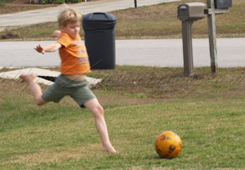 Roo kicking soccer ball