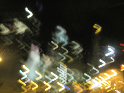 city lights in moving car
