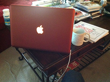 MacBook with terracotta case