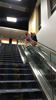 RPF volunteers on escalator